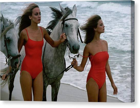 Models With Horses On A Beach Canvas Print