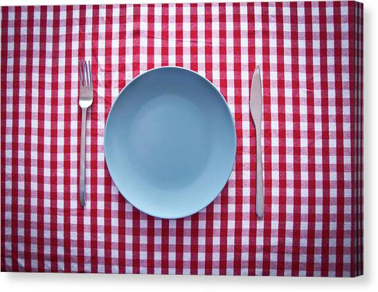 Modern Blue Plate On Red Checkered Canvas Print