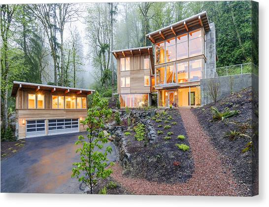 Modern House Illuminated In Woods Canvas Print by Will Austin