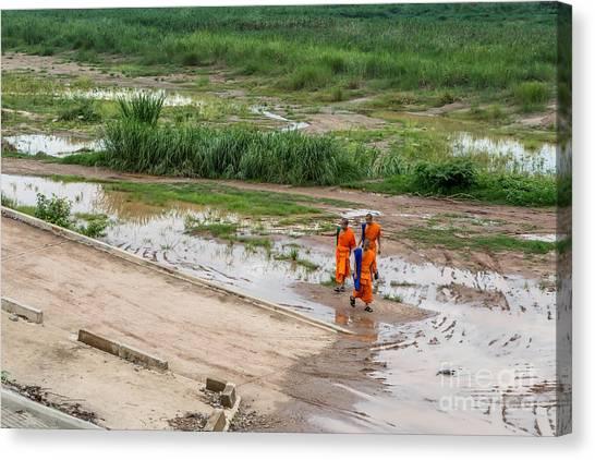 5cbc5800edc84 Stinson Canvas Print - Monks In The Mekong Riverbed by Jennifer Stinson