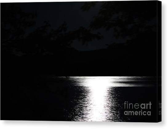 Canvas Print featuring the photograph Moon On Waterton Lake by Ann E Robson