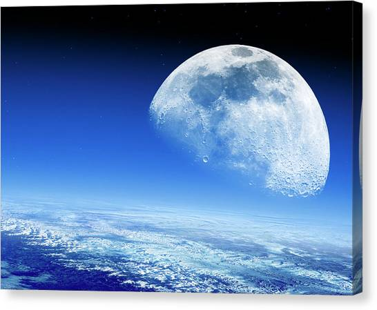 Moon Rising Over Earth's Horizon Canvas Print by Detlev Van Ravenswaay