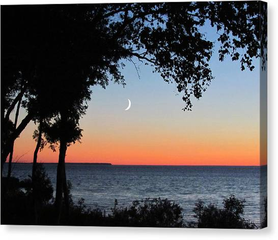 Moon Sliver At Sunset Canvas Print