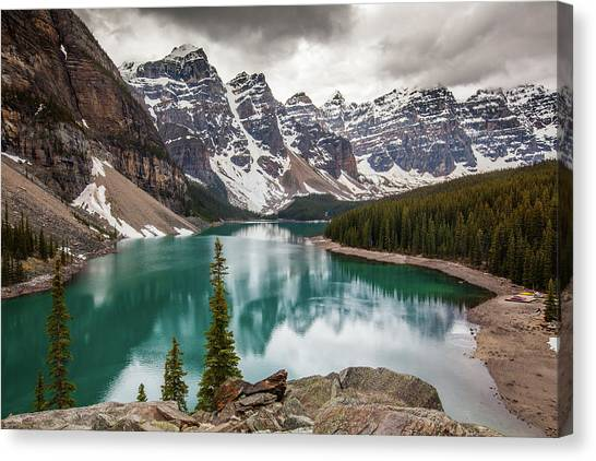 Moraine Lake On Cloudy Day Canvas Print by Putt Sakdhnagool
