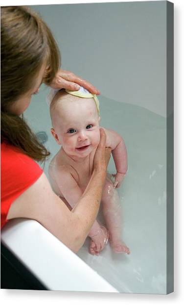 Flannel Canvas Print - Mother Bathing Her Baby Boy by Suzanne Grala/science Photo Library