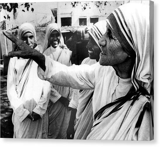 Charities Canvas Print - Mother Teresa Points Something Out by Retro Images Archive