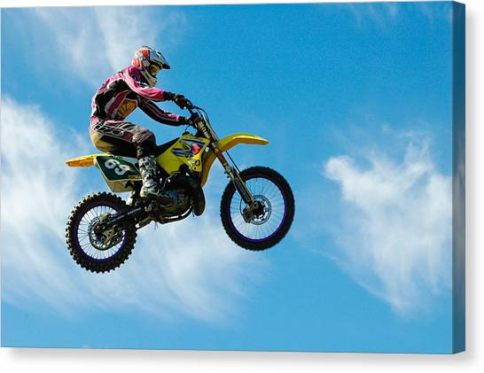 Motocross Canvas Print - Motocross Rider Jumping High - Blue Sky by Matthias Hauser