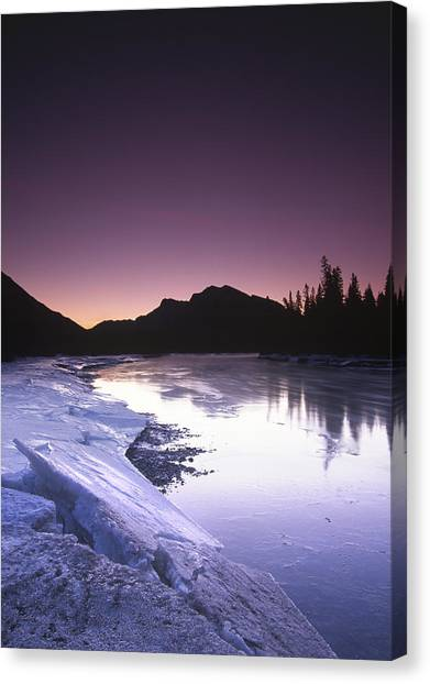 Mount Mcgillvary Silhouetted Behind An Icy Bow River Canvas Print by Richard Berry
