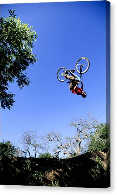 Freeriding Canvas Print - Mountain Biker Does A Backflip by Scott Markewitz