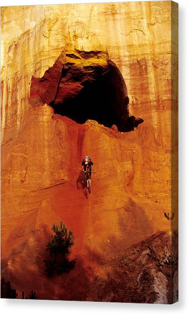 Freeriding Canvas Print - Mountain Biker Drops From Cave by Scott Markewitz