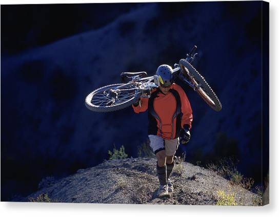 Freeriding Canvas Print - Mountain Biker Hikes With Bike by Chris Giles