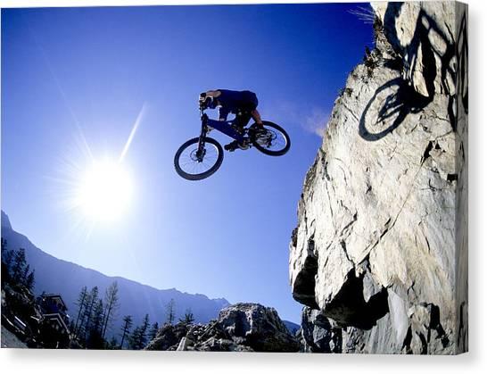 Freeriding Canvas Print - Mountain Biker Making A Jump by Scott Markewitz