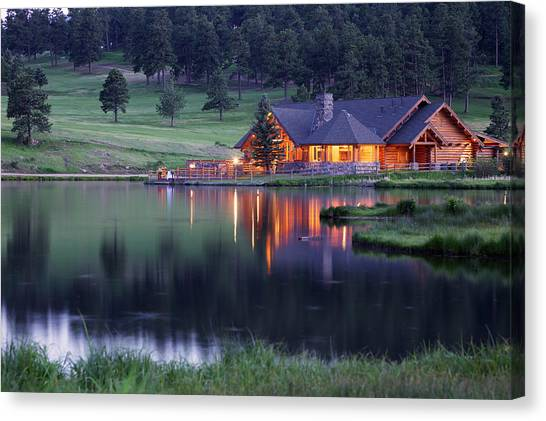Mountain Lodge Reflecting In Lake At Canvas Print by Beklaus