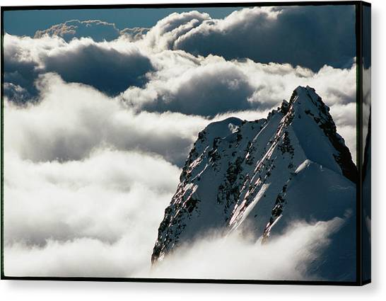 Fox Glacier Canvas Print - Mountain Peak Breaking Clouds by Richard Hallman