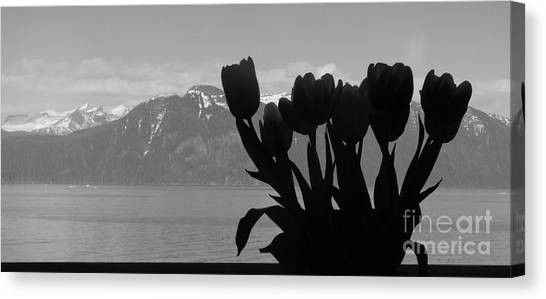 Mountains And Tulips Canvas Print by Laura  Wong-Rose
