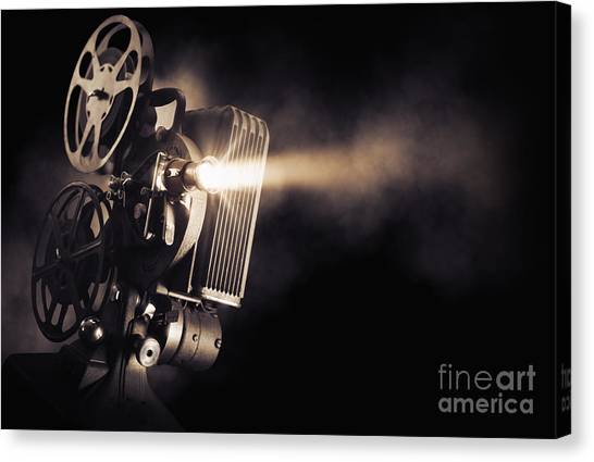 Dust Canvas Print - Movie Projector On A Dark Background by Fer Gregory