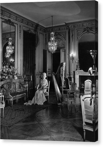 Stringed Instruments Canvas Print - Mrs. Cornelius Sitting In A Lavish Music Room by Cecil Beaton