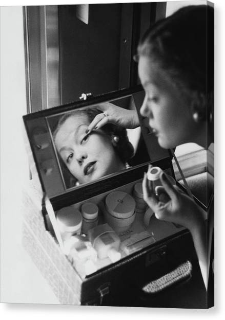 Mrs. Thomas Phipps Applying Make-up Canvas Print by Constantin Joffe