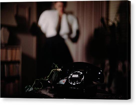 Mrs. Tyron Behind A Telephone Canvas Print by John Rawlings