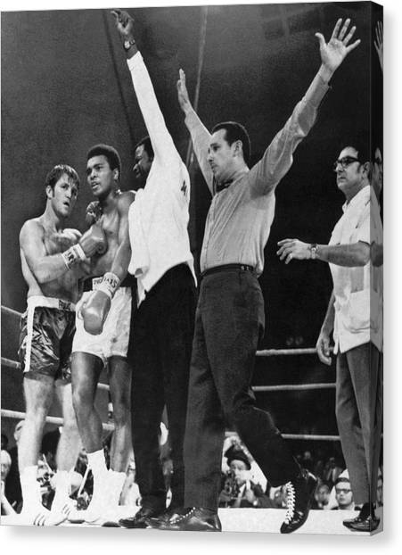 Muhammad Ali Canvas Print - Muhammad Ali And Jerry Quarry by Underwood Archives