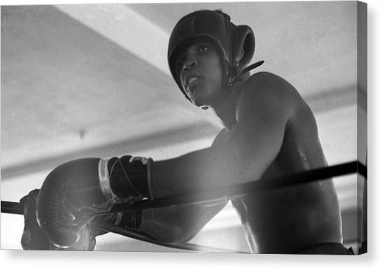Muhammad Ali Canvas Print - Muhammad Ali Gloves Resting On Ropes by Retro Images Archive