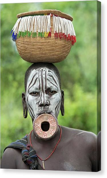 Ethiopian Woman Canvas Print - Mursi Woman With Lip Plate And Basket by Tony Camacho