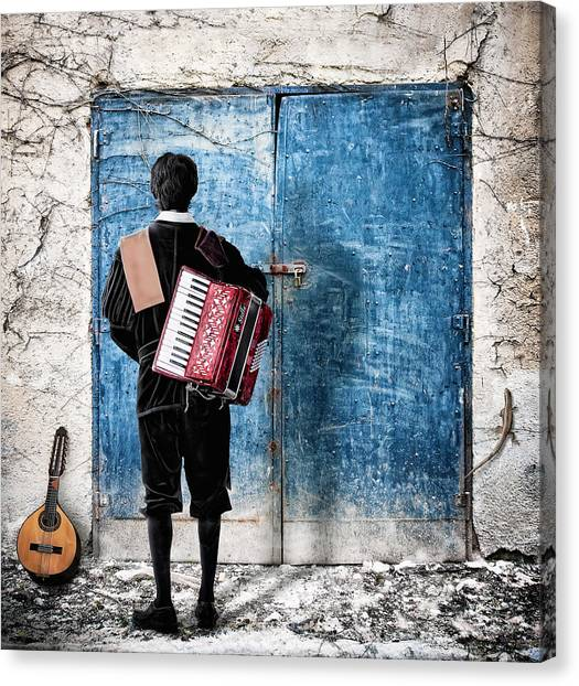 Musician At The Door Canvas Print by Nermin Smajic