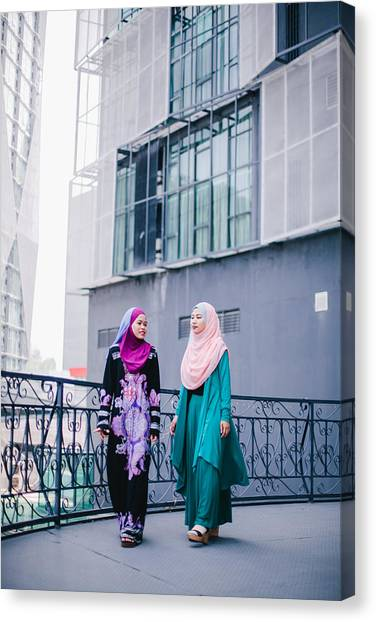 Muslim Women In Hijab In Discussion Canvas Print by Mikhaella Ismail