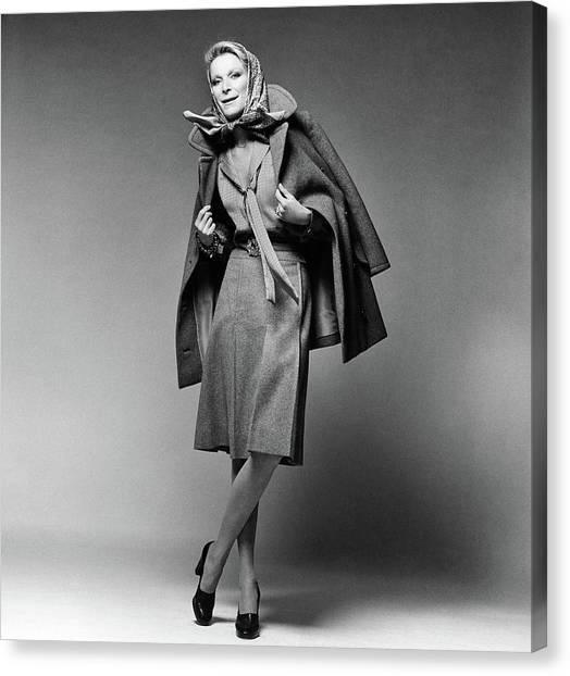 Flannel Canvas Print - Nan Kempner Wearing A Pea Jacket And Skirt by Francesco Scavullo