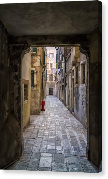 Narrow Street In Venice Canvas Print by Francesco Rizzato