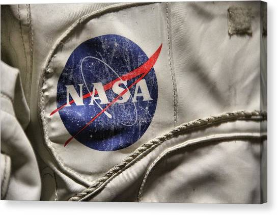 Space Suit Canvas Print - Nasa by Dan Sproul