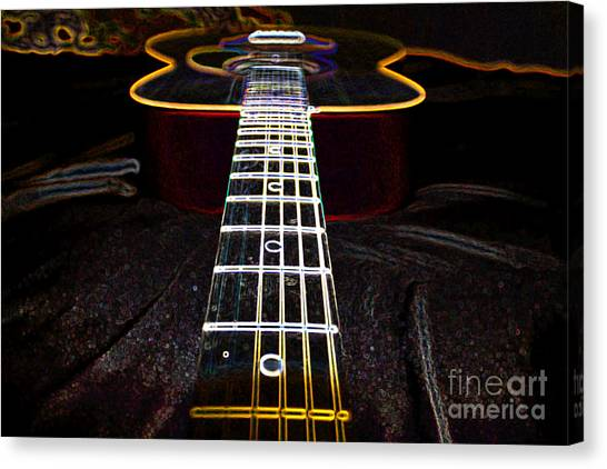 Neon Guitar Canvas Print by Paul Muscat