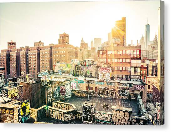 City Sunsets Canvas Print - New York City - Graffiti Rooftops Of Chinatown At Sunset by Vivienne Gucwa