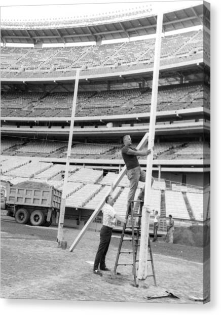 Dump Trucks Canvas Print - New York Jets Football Crew Works On Field Goal Repairs by Retro Images Archive