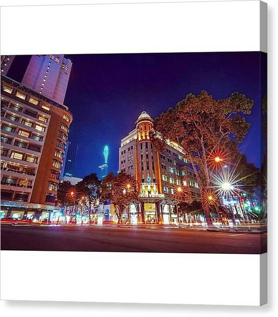 Sunny Canvas Print - Đồng Khởi Corner Le Loi Avenue, Ho by Sunny Merindo