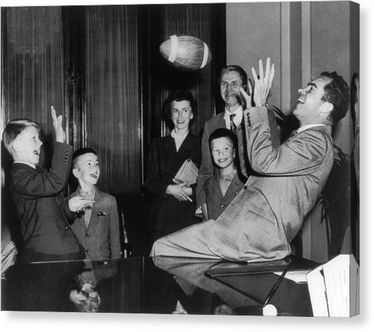 Republican Presidents Canvas Print - Nixon Catching Football by Underwood Archives