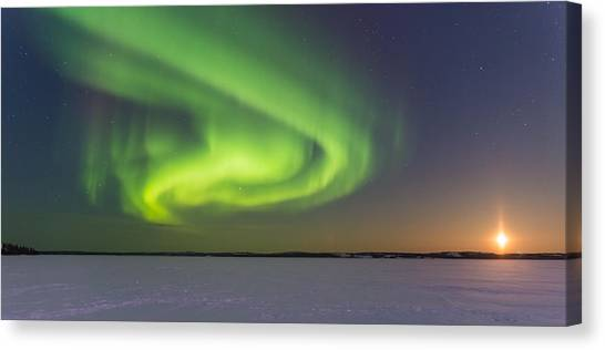 Northern Lights And Moon Canvas Print by Craig Brown