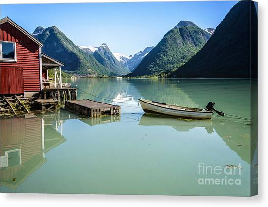 Reflection Of A Boat And A Boathouse In A Fjord In Norway Canvas Print