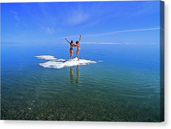Northwest Territories Canvas Print - Nude Young Couple Playing On An Ice by Stephen Gorman