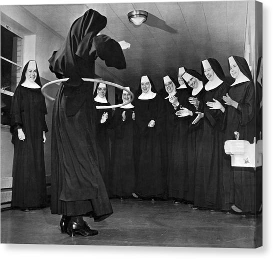 Nuns Canvas Print - Nun Swivels Hula Hoop On Hips by Underwood Archives