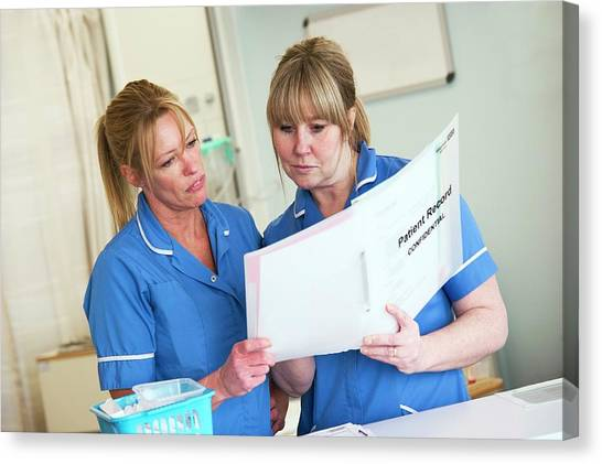 Folders Canvas Print - Nurses Discussing Patient Records by Lth Nhs Trust/science Photo Library