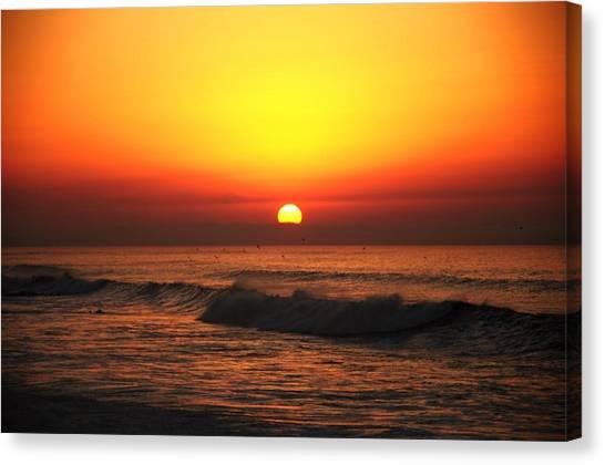 Ocean Sunset Canvas Print by Manu G