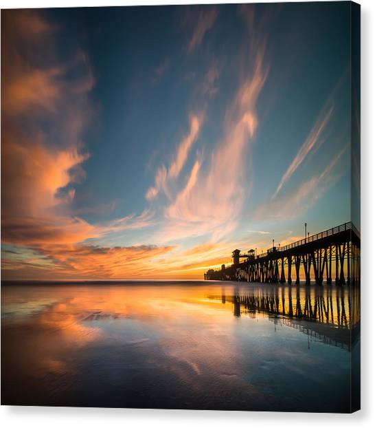 Oceanside Reflections 3 Square Canvas Print by Larry Marshall