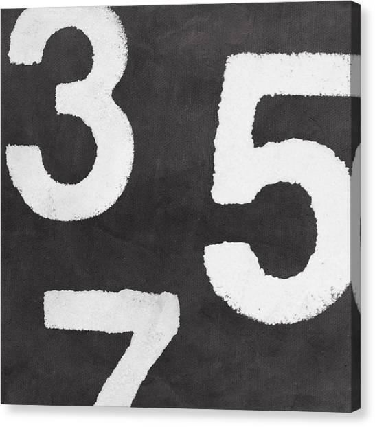 Black And White Art Canvas Print - Odd Numbers by Linda Woods