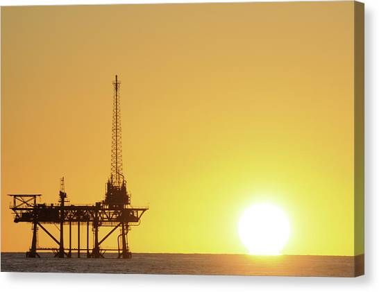 Offshore Oil Rig And Sun Canvas Print