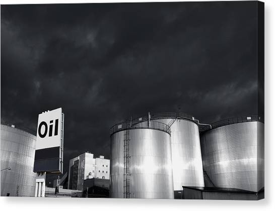 Oil Refinery At Sunset With Commercial Sign Canvas Print