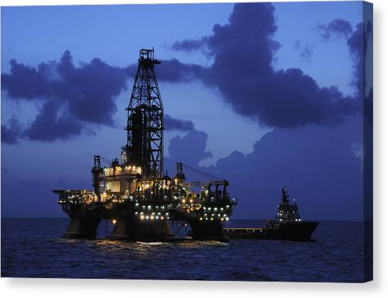 Oil Rig And Vessel At Night Canvas Print