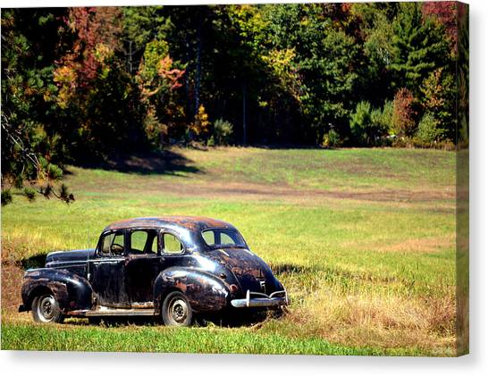 Old Car In A Meadow Canvas Print