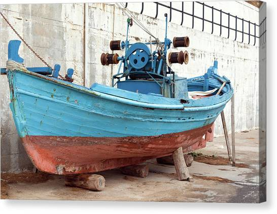 Old Colorful Fishing Boat Next To A Canvas Print