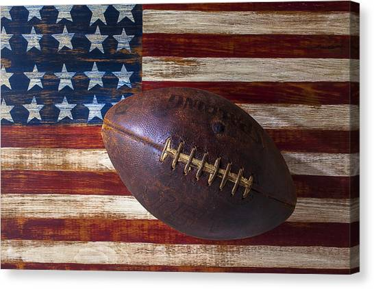American Flag Canvas Print - Old Football On American Flag by Garry Gay